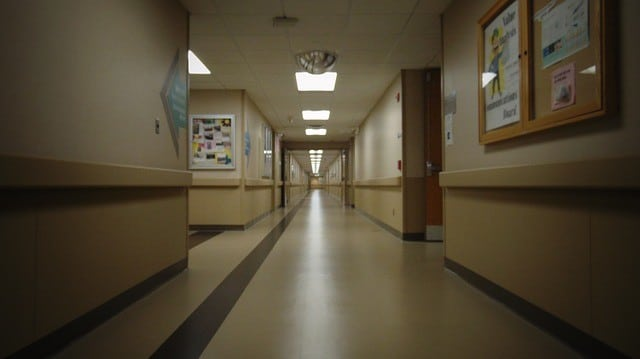 Long empty nursing home hallway