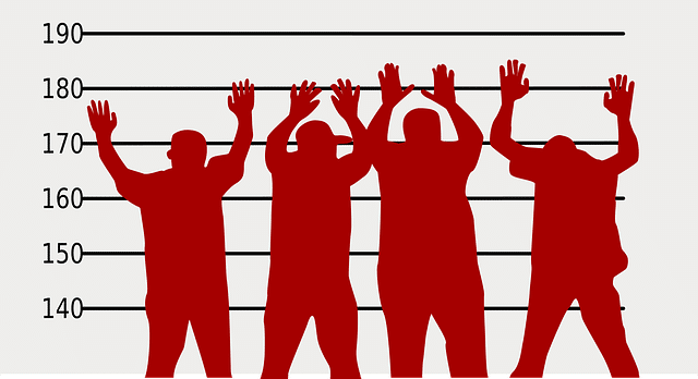 Red silhouettes of people with arms raised in front of white screen with horizontal bars as in height measurements for booking photo