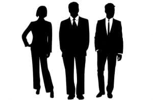Silhouette of three business people in suits