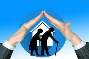 white house icon in blue circle, with silhouette of hunched older couple, all under an image of a pair of hands making protective tent over them.