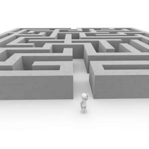 Drawing of a maze with a person standing at the entrance