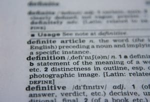 "Close up photo of page in the dictionary with the focus on the word ""definition"""