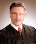 Headshot of Cuyahoga County Probate Court Presiding Judge Anthony J. Russo in back robe over white shirt wearing red tie.
