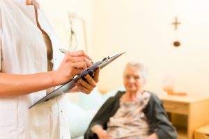 Young nurse does assessment on elderly woman