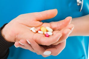 Hand full of medications