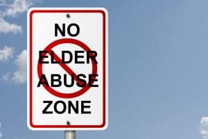 Road sign with no elder abuse zone written on it