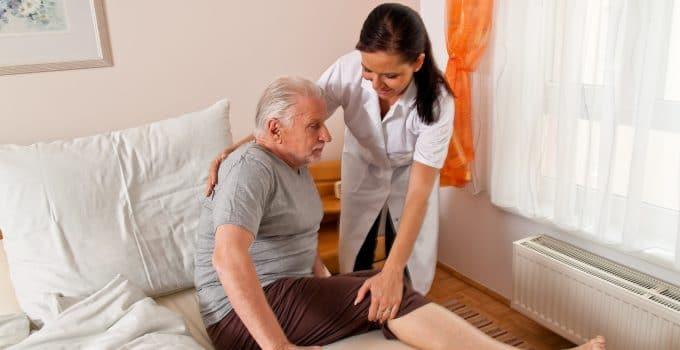 Man getting helped by nurse