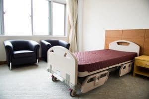 Clean empty bed in a hospital ward