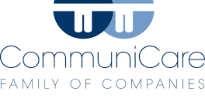 Communicare Logo of Two People over Silhouette