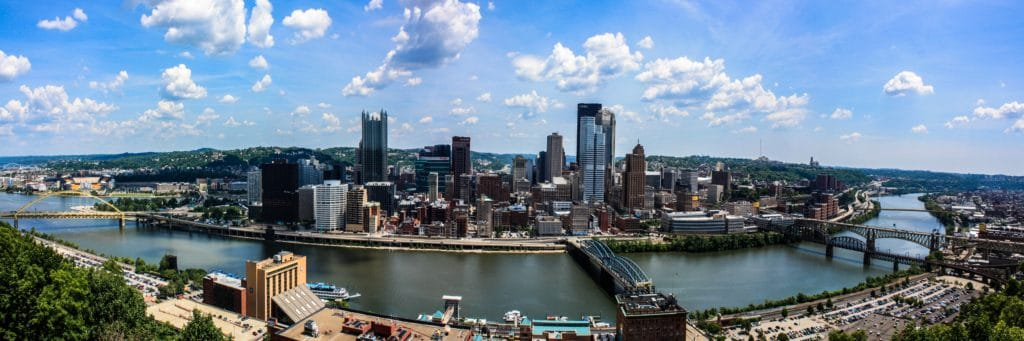 panoramic aerial view of Pittsburgh skyline with river in foreground